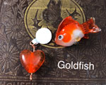 The fish bead is CiM Peace with a layer of London Fog and Goldfish. Both London Fog and Goldfish were the perfect consistency for sculpting- stiff but not too stiff.