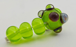 Chartreuse with silver glass dots encased in clear bumps to magnify the reaction.