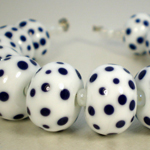 Lapis dots on opaque white