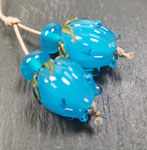 These flower bud beads are made with a core of Andrew with Effetre light aqua petals over the top.
