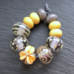The beads here are CiM Koala encased with CiM Moonlight with decoration and spacers in Yellow Brick Road.